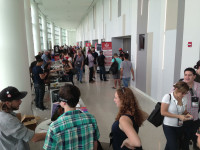 Wordcamp Miami attendees milling, kibitzing in front hallway.