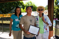 Major Louis Caputo (Monroe County Sheriff's Department) receiving Certificate of Appreciation from Friends of Old Settlers Park leaders Jill Patterson (left) and Sylvia Murphy.